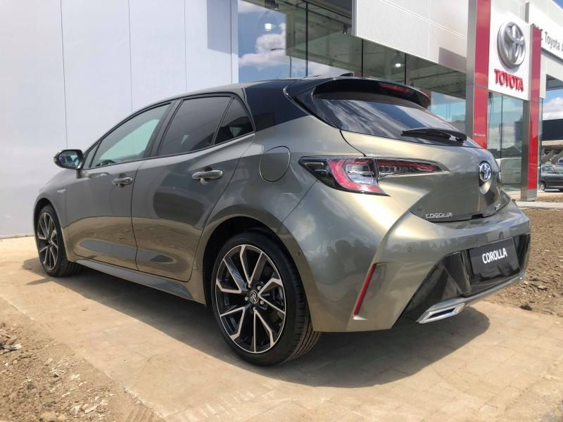 Nieuw Toyota Corolla hb & ts Hatchback 2.0 HYBRID e-CVT Premium LHD 2RF - OXIDE BRONZE/BLACK ROOF 8